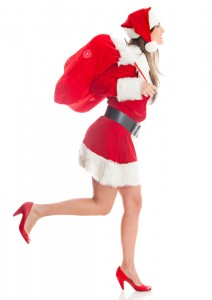 Female Santa running with a gift sack